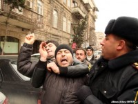 Youth activists are corraled by police in Baku on March 11, when Facebook activists called for 'Great People's Day.'